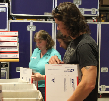 Dave Bray of Madison Rising Packing Boxes for Soldiers' Angels
